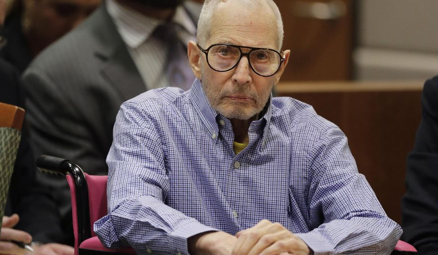 FILE - In this Dec. 21, 2016, file photo, real estate heir Robert Durst sits in a courtroom during a hearing in Los Angeles. A retired New York police detective says the missing wife of New York real estate heir Robert Durst once went to her neighbor's in pajamas and said her husband beat her and she feared he would kill her. James Varian testified Tuesday, April 25, 2017, that a neighbor reported Kathleen Durst had knocked on her Manhattan penthouse bedroom window for help. (AP Photo/Jae C. Hong, Pool, File)