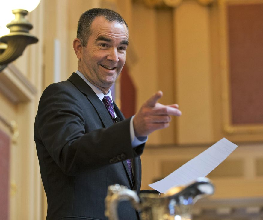 """FILE- In this Jan. 29, 2016, file photo, Virginia Lt. Gov. Ralph Northam gestures as he reads a statement during the Senate session at the Capitol in Richmond, Va. Now a candidate for governor, Northam has tried to shed his image as the genteel pediatric neurologist who calmly presides over the slow moving state Senate in favor of a more aggressive politician eager to take on President Trump. """"I know how to fight, I know how to win fights,"""" said Northam. (AP Photo/Steve Helber, File)"""
