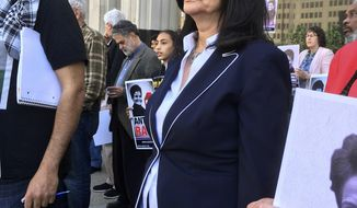 Rasmea Odeh, stands outside federal court Tuesday, April 25, 2017, in Detroit. Odeh, a Chicago Palestinian activist who didn't disclose her time in an Israeli prison when she got U.S. citizenship, agreed to plead guilty to failing to tell U.S. immigration officials in 2004 that she was convicted and imprisoned in Israel for bombings in the late 1960s. (AP Photo/Ed White)