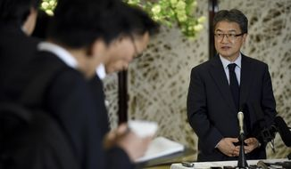 """U.S. special representative for North Korea policy Joseph Yun, center, answers questions from reporters following meeting with Japanese and South Korean chief nuclear negotiators to talk about North Korean issues at the Iikura Guesthouse in Tokyo Tuesday, April 25, 2017. North Korea marks the founding anniversary of its military on Tuesday, and South Korea and its allies are bracing for the possibility that it could conduct another nuclear test or launch an intercontinental ballistic missile for the first time.   U.S. envoy Yun says he and his counterparts from Japan and South Korea agreed to coordinate """"all actions"""" on North Korea. (Toru Yamanaka/Pool Photo via AP)"""