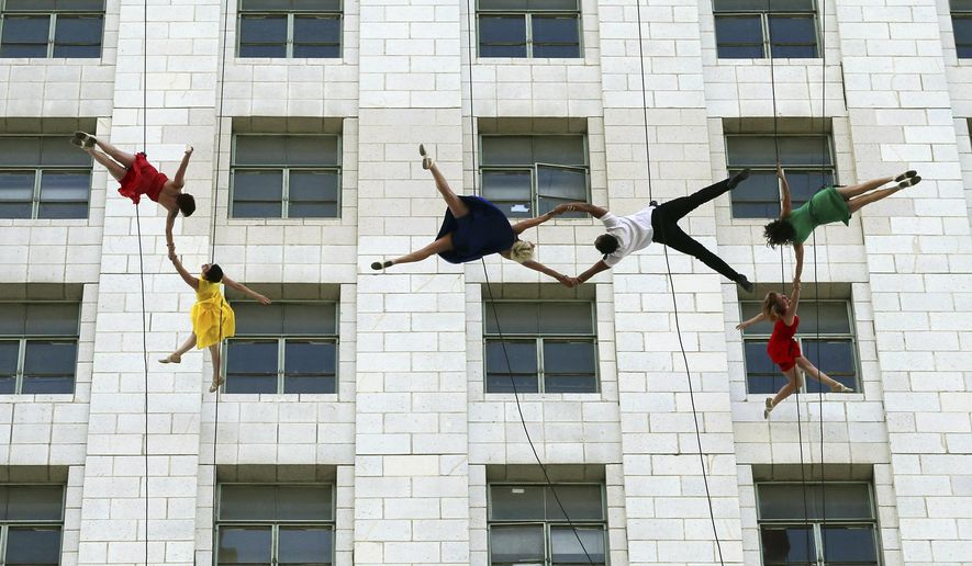 "Dancers from Bandaloop aerial dance troupe perform to a medley of songs and dances from the movie ""La La Land"" off the side of Los Angeles City Hall, during ""La La Land Day"" festivities Tuesday, April 25, 2017. Mayor Eric Garcetti proclaimed the honor for the musical that claimed six Academy Awards in February.  (AP Photo/Reed Saxon)"