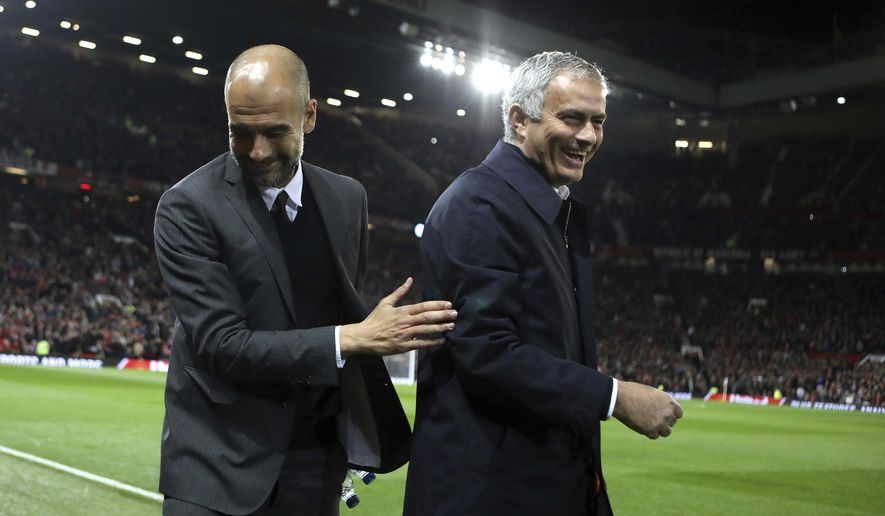 FILE - In this Wednesday, Oct. 26, 2016 file photo, Manchester City's manager Pep Guardiola, left, and Manchester United's manager Jose Mourinho smile ahead of their English League Cup soccer match at Old Trafford stadium in Manchester. There were handshakes, smiles, even an embrace, in the first two head-to-heads between Pep Guardiola and Jose Mourinho in English soccer. With the pressure and tension ramped up a notch for the third Manchester derby of the season, will the two coaching adversaries be able to retain their new-found cordiality on Thursday, April 27? (AP Photo/Dave Thompson, file)