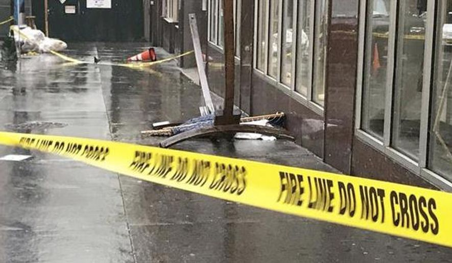 In this April 25, 2017 photo provided by ABC 7 Eyewitness News in New York, a wooden hammock lay on the sidewalk in New York. Police say that an tourist from England was injured and taken to the hospital when the hammock fell from the building she was talking near and struck her. Police believe wind may have blown the wooden framed hammock off the building's terrace. (ABC 7 Eyewitness News via AP)