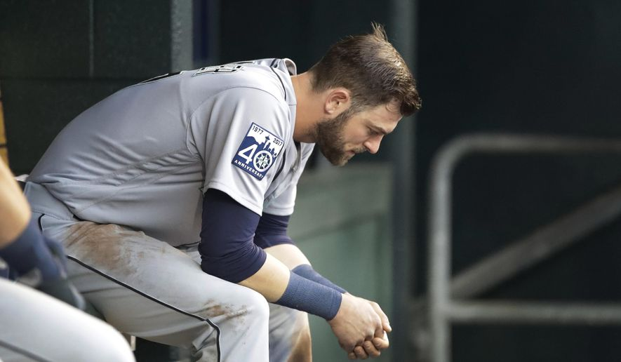 Seattle Mariners' Mitch Haniger sits on the bench after being pulled for a pinch-runner during the third inning of the team's baseball game against the Detroit Tigers, Tuesday, April 25,2017, in Detroit. (AP Photo/Carlos Osorio)