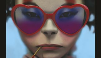 "This cover image released by Warner Bros. shows ""Humanz,"" the latest release by Gorillaz. (Warner Bros. via AP)"