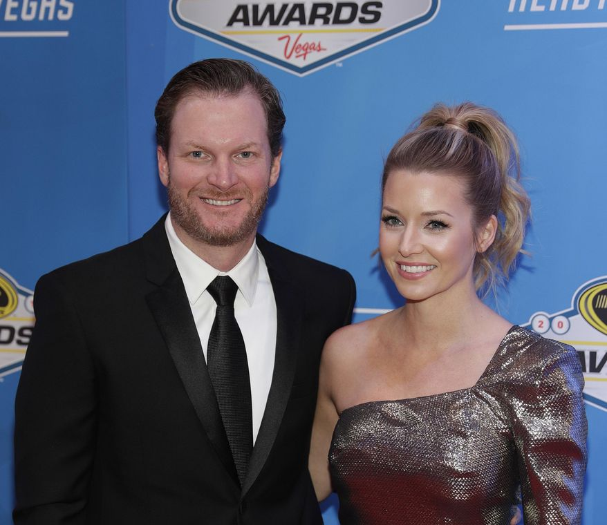 FILE - In this Dec. 2, 2016, file photo, Dale Earnhardt Jr., left, and Amy Reimann pose on the red carpet during the NASCAR Sprint Cup Series auto racing awards in Las Vegas. Dale Earnhardt Jr., NASCAR's most popular driver, announced Tuesday, April 25, 2017, that will retire at the end of the season. Earnhardt turns 43 in October, was married during the offseason and has stated he wants a family. (AP Photo/John Locher, File)