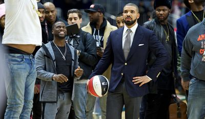 FILE - In this  Feb. 12, 2016, file photo, Kevin Hart, left, and Drake coach at the NBA All-Star Celebrity Game at Ricoh Coliseum in Toronto. The league announced on April 25, 2017, that Drake will host its first NBA Awards on June 26. (Photo by Ryan Emberley/Invision/AP, File)