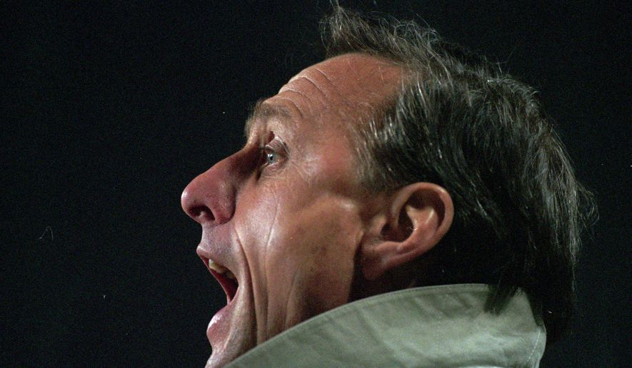 -FILE- In this March 1996 file photo soccer coach Johan Cruyff shouts during a soccer match in Eindhoven, Netherlands. On the day Johan Cruyff would have turned 70, his home city has agreed to name Ajax's stadium after the Dutch football legend. Amsterdam Municipality says it has agreed with the stadium and Ajax to change the name of the Amsterdam Arena to the Johan Cruijff Arena, using the Dutch spelling of the Ajax and Barcelona star, who died last year.(AP Photo/Peter Dejong)