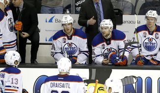 Edmonton Oilers head coach Todd McLellan, center, talks with his players during a time-out against the San Jose Sharks in the third period in Game 6 of a first-round NHL hockey playoff series Saturday, April 22, 2017, in San Jose, Calif. The Oilers won 3-1. (AP Photo/Tony Avelar)