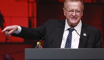 FILE - In this Nov. 30, 2016, file photo, IOC Vice President John Coates delivers a speech during the closing plenary session of the IOC Debriefing of the Olympic Games Rio 2016, in Tokyo. An increasingly bitter Olympic election in Australia has intensified with Coates describing the campaign against him as malicious and designed to damage him personally. Coates is facing his first challenge as president of the Australian Olympic Committee in 27 years, with 1996 Olympic field hockey gold medalist Danni Roche running against him in a May 6, 2017 ballot. (AP Photo/Eugene Hoshiko, File)