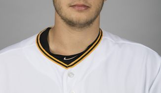 This is a 2017 photo of Dovydas Neverauskas of the Pittsburgh Pirates. This image represents the the Pirates active roster in Bradenton, Fla. The Pirates called up Neverauskas from Triple-A Indianapolis on Monday, April 24, 2017 giving the reliever the chance to become the second Lithuanian-born player to appear in a major league game (AP Photo/Matt Rourke)