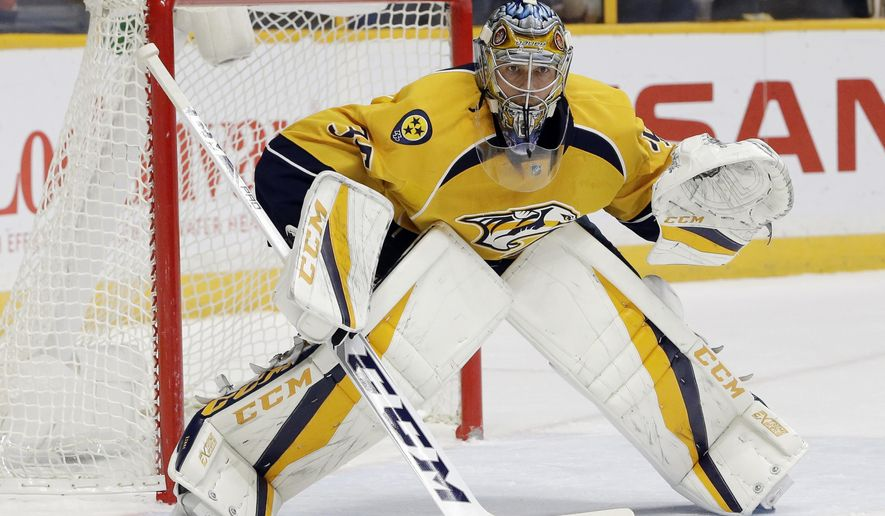 FILE - In this Dec. 6, 2016, file photo, Nashville Predators goalie Pekka Rinne, of Finland, plays against the Colorado Avalanche during the first period of an NHL hockey game, in Nashville, Tenn. No goaltender has played better this postseason than Rinne for Predators, though Jake Allen of the St. Louis Blues came closest.  (AP Photo/Mark Humphrey, File)