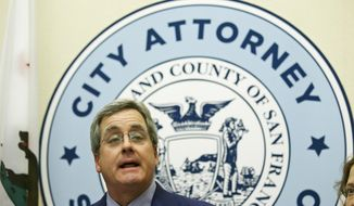 """City Attorney Dennis Herrera talks about a federal judge's order blocking any attempt by the Trump administration to withhold money from """"sanctuary cities """"during a news conference at City Hall Tuesday, April 25, 2017, in San Francisco. (AP Photo/Eric Risberg)"""