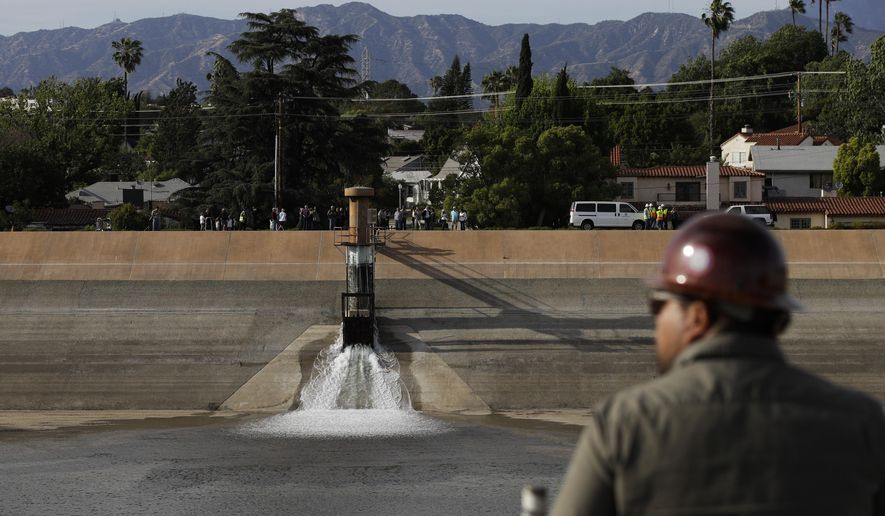 Water flows into the Silver Lake Reservoir Complex Tuesday, April 25, 2017, in Los Angeles. Two years after authorities drained the reservoirs in Los Angeles, the water is flowing in again. Officials on Tuesday began the process of refilling the 96-acre Silver Lake and Ivanhoe reservoirs, which once held drinking water and was a landmark in the arty, upscale neighborhood. (AP Photo/Jae C. Hong)