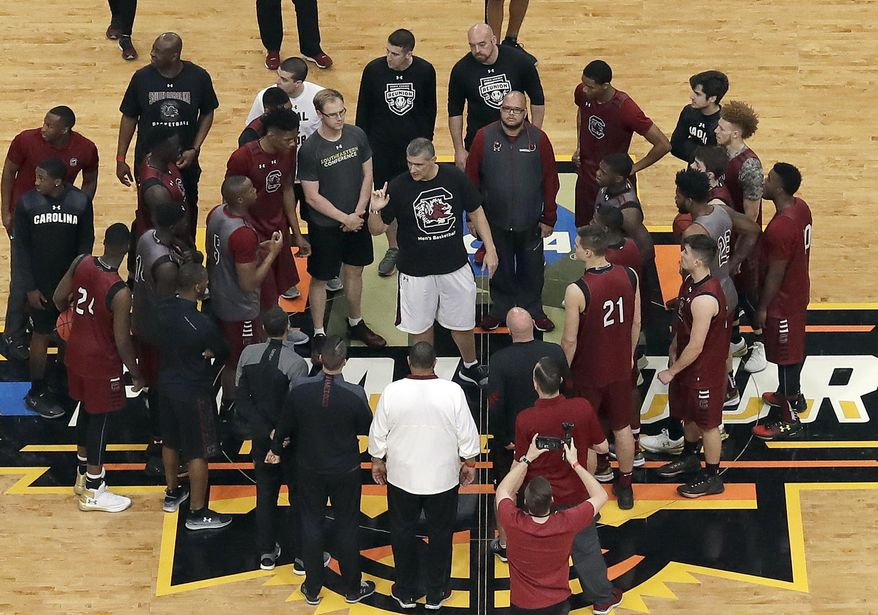 FILE - In this March 31, 2017, file photo, South Carolina coach Frank Martin talks to his team during practice for a semifinal in the NCAA men's college basketball tournament Final Four, in Glendale, Ariz. Martin is determined the Final Four appearance won't be a one-time thing. He faces an uphill challenge, losing his core leaders and starting point guard off that squad. (AP Photo/Morry Gash, File)