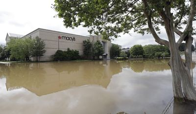 Floodwater fills the parking lot of Macy's at Crabtree Valley Mall in Raleigh, N.C., Tuesday, April 25, 2017. Storms have dumped several inches of rain on North Carolina's capital, prompting firefighters to rescue people from their vehicles and delaying school bus schedules. (AP Photo/Gerry Broome)