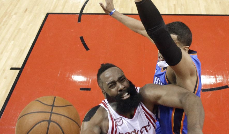 Houston Rockets' James Harden (13) goes up for a shot as Oklahoma City Thunder's Andre Roberson defends during the first half in Game 5 of an NBA basketball first-round playoff series, Tuesday, April 25, 2017, in Houston. (AP Photo/David J. Phillip)
