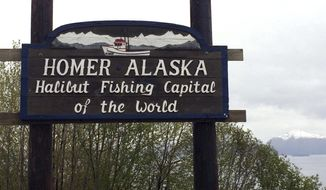 File - In this May 23, 2015 file photo, the welcome sign is displayed on the outskirts of Homer, Alaska. Three leaders of the Alaska fishing community who wanted to promote inclusivity are fighting efforts to recall them from office. The recall election targeting three Homer City Council members is pegged to resolutions supporting the Standing Rock Sioux Tribe in its fight over a pipeline and aimed at promoting inclusivity in Homer following President Donald Trump's election. (AP Photo/Mark Thiessen, File)