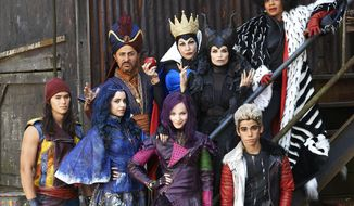 """This image released by the Disney Channel shows cast members of the film, """"Descendants"""" stars Booboo Stewart, foreground from left, Sofia Carson, Dove Cameron, Cameron Boyce, and background from left, Maz Jobrani, Kathy Najimy, Kristin Chenoweth and Wendy Raquel Robinson. The Disney Channel is giving a big push to its sequel for the """"Descendants"""" movie in July, premiering it simultaneously on five television networks and online. Disney said Tuesday that """"Descendants 2"""" will air July 21 on ABC, the Disney Channel, Lifetime, Freeform and Disney XD, as well as on those network's apps. The original movie, about the teen-aged sons and daughters of some famed Disney villains, ranked as the fifth most-watched cable TV movie when it came out two years ago. (Bob D'Amico/Disney Channel via AP)"""