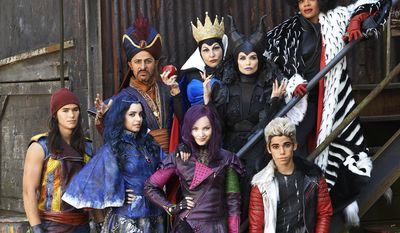 "This image released by the Disney Channel shows cast members of the film, ""Descendants"" stars Booboo Stewart, foreground from left, Sofia Carson, Dove Cameron, Cameron Boyce, and background from left, Maz Jobrani, Kathy Najimy, Kristin Chenoweth and Wendy Raquel Robinson. The Disney Channel is giving a big push to its sequel for the ""Descendants"" movie in July, premiering it simultaneously on five television networks and online. Disney said Tuesday that ""Descendants 2"" will air July 21 on ABC, the Disney Channel, Lifetime, Freeform and Disney XD, as well as on those network's apps. The original movie, about the teen-aged sons and daughters of some famed Disney villains, ranked as the fifth most-watched cable TV movie when it came out two years ago. (Bob D'Amico/Disney Channel via AP)"