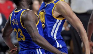 Golden State Warriors forward Draymond Green, left, and Golden State Warriors center JaVale McGee react after a McGee dunk against the Portland Trail Blazers during the first half of Game 4 of an NBA basketball first-round playoff series Monday, April 24, 2017, in Portland, Ore. (AP Photo/Craig Mitchelldyer)