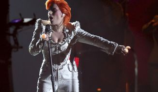 FILE - In this Feb. 15, 2016, file photo, Lady Gaga performs a tribute to David Bowie at the 58th annual Grammy Awards in Los Angeles. Gaga's tribute won a pair of Webby Awards announced on April 25, 2017. (Photo by Matt Sayles/Invision/AP, File)