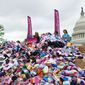 Pro-life demonstrators deliver nearly 200,000 pairs of baby socks to the U.S. Capitol as a public demonstration aimed at encouraging Congress to defund Planned Parenthood, the nation's largest abortion provider, in this April 2017 file photo. (Students for Life of America) ** FILE **