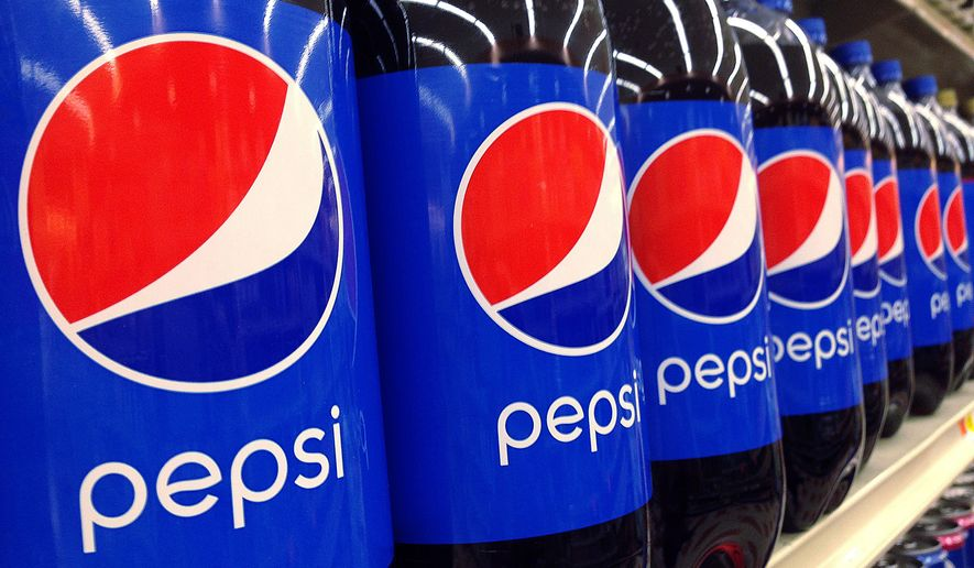 FILE - In this July 9, 2015, file photo, Pepsi bottles are on display at a supermarket in Haverhill, Mass. PepsiCo Inc. reports earnings, Wednesday, April 26, 2017. (AP Photo/Elise Amendola, File)
