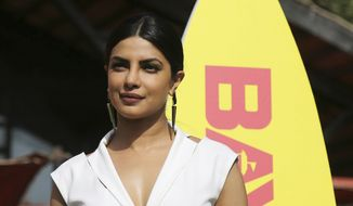 "Bollywood actress Priyanka Chopra poses during an event to promote her upcoming hollywood film ""Baywatch"" in Mumbai, India, Wednesday, April 26, 2017. (AP Photo/Rajanish Kakade)"