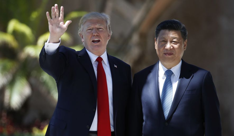 "At President Trump's Mar-a-Lago resort on April 7, he informed Chinese President Xi Jinping over a ""beautiful"" piece of chocolate cake that he had authorized airstrikes against Syria. (Associated Press/File)"
