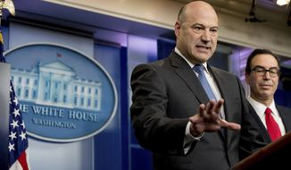 National Economic Director Gary Cohn, left, accompanied by Treasury Secretary Steve Mnuchin, speaks in the briefing room of the White House in Washington, Wednesday, April 26, 2017, where they discussed President Donald Trump tax proposals. (AP Photo/Andrew Harnik)