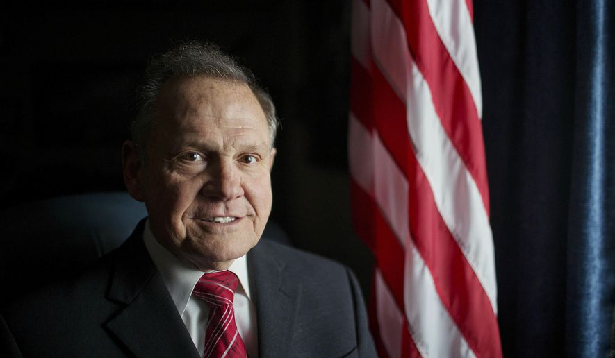 FILE - In this Feb. 17, 2015, file photo, Alabama Chief Justice Roy Moore poses for a photo in Montgomery, Ala. Moore scheduled a news conference Wednesday, April 26, 2017, on the steps of the Alabama Capitol to announce his plans for the future. (AP Photo/Brynn Anderson, File)
