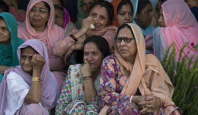Women grieve as they await the arrival of the body of Indian paramilitary soldier Sanjay Kumar at his home in Palampur, about 40 kilometers (25 miles) south of Dharmsala, India, Tuesday, April 25, 2017. Kumar was among 25 Indian paramilitary soldiers who were killed by Maoist rebels in central India on Monday in one of the worst attacks on the country's security forces in recent years. (AP Photo/Ashwini Bhatia)