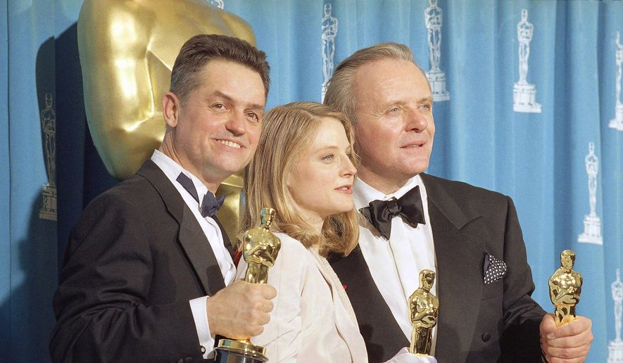 "In this May 31, 1992, file photo, director Jonathan Demme, left, holds his award for best director, actress Jodie Foster holds her award for best actress, and actor Anthony Hopkins holds his award for best actor for their work on ""Silence of the Lambs,"" at the Academy Awards in Los Angeles. Demme died, Wednesday, April 26, 2017, from complications from esophageal cancer in New York. He was 73. (AP Photo/Reed Saxon, File)"