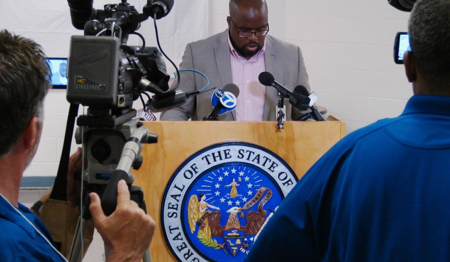 In this Monday, April 24, 2017, photo, Solomon Graves, a spokesman for the Arkansas Department of Correction, speaks to reporters at the Cummins Unit prison in Varner, Ark. Graves' agency relies on reporters and citizen witnesses to verify that the state has conducted an execution. A fourth execution this month is set for Thursday. (AP Photo/Kelly P. Kissel)