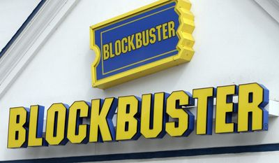 FILE - In this Sept. 22, 2010, file photo, a Blockbuster sign on a store is seen in Barre, Vt. The parents of an autistic Texas man recreated a Blockbuster for their son at their home after the story he visited twice a week closed on April 23, 2017. (AP Photo/Toby Talbot, File)