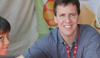 FILE - This April 21, 2012 file photo shows Jeff Kinney at the LA Times Festival of Books in Los Angeles. The first 11 novels have sold more than 180 million copies and the series has been the basis for four movies.  (AP Photo/Katy Winn, File)