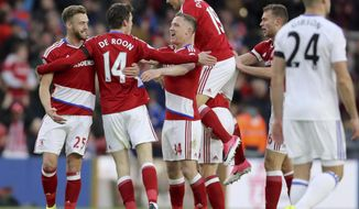 Middlesbrough's Marten de Roon, 2nd left, celebrates scoring his side's first goal of the game against Sunderland, during the English Premier League soccer match at the Riverside Stadium in Middlesbrough, England, Wednesday April 26, 2017. (Owen Humphreys/PA via AP)