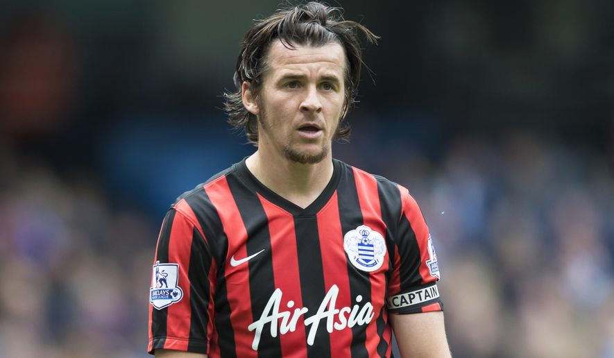 FILE - In this file photo dated Sunday May 10, 2015, Queens Park Rangers' Joey Barton during the English Premier League soccer match between Manchester City and Queens Park Rangers at the Etihad Stadium in Manchester, England.  The 34-year old Barton has been banned for 18-months by the English Football Association after placing 1,260 bets on soccer over the last 11-years, including games he played in. (AP Photo/Jon Super, FILE)