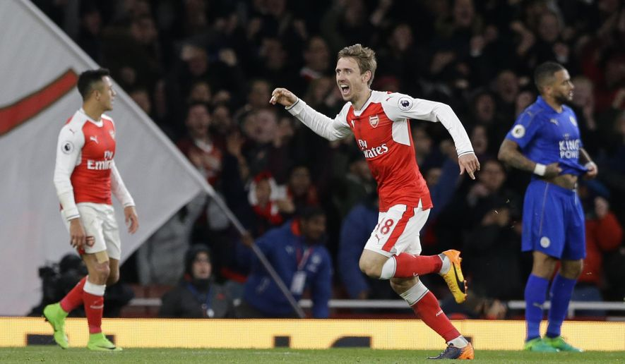 Arsenal's Nacho Monreal celebrates after scoring the opening goal of the game during the English Premier League soccer match between Arsenal and Leicester City at the Emirates Stadium in London, Wednesday, April 26, 2017. (AP Photo/Alastair Grant)