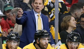 FILE - In this April 8, 2017, file photo, Boston Bruins interim head coach Bruce Cassidy works behind the bench in the third period of an NHL hockey game against the Washington Capitals. The Bruins said on Wednesday, April 26, 2017, it will drop the interim tag and Cassidy will return next season as the team's head coach. Cassidy replaced Claude Julien in February and helped the team return to the playoffs for the first time in three seasons. (AP Photo/Winslow Townson, File)