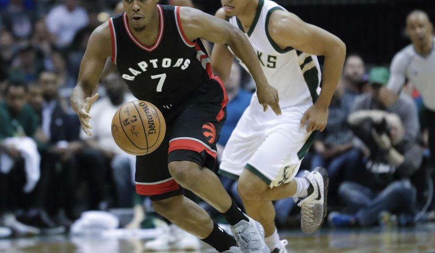 FILE - In this April 22, 2017, file photo, Toronto Raptors' Kyle Lowry steals the ball from Milwaukee Bucks' Malcolm Brogdon during the first half of Game 4 of an NBA first-round playoff series basketball game, in Milwaukee. The Bucks are building an athletic club that could run roughshod over NBA foes in the near future. For now, a team lacking playoff experience is learning hard lessons in a first-round series with Toronto. (AP Photo/Morry Gash, File)
