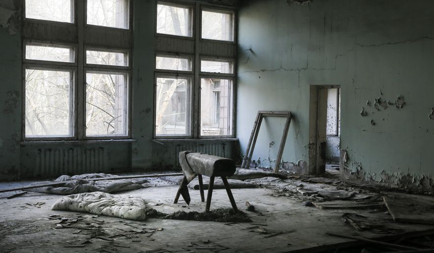 This photo taken Wednesday, April 5, 2017, shows a gymnasium in a school in the deserted town of Pripyat, some 3 kilometers (1.86 miles) from the Chernobyl nuclear power plant Ukraine. Once home to some 50,000 people whose lives were connected to the Chernobyl nuclear power plant, Pripyat was hastily evacuated one day after a reactor at the plant 3 kilometers (2 miles away) exploded on April 26, 1986. The explosion and the subsequent fire spewed a radioactive plume over much of northern Europe. (AP Photo/Efrem Lukatsky)
