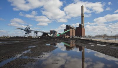 FILE - In this April 12, 2016, file photo, a few tons of coal remain on the coal field at B.C. Cobb Plant in Muskegon, Mich. Consumers Energy has selected Forsite Development Inc., to demolish and redevelop its 115-acre B.C. Cobb Generating Plant in Muskegon and 248-acre J.R. Whiting Generating Complex in Luna Pier, near Monroe. (Joel Bissell//Muskegon Chronicle via AP, File)