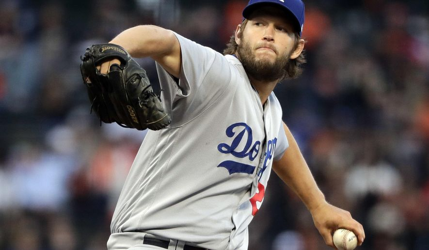 Los Angeles Dodgers starting pitcher Clayton Kershaw throws to a San Francisco Giants batter during the first inning of a baseball game Tuesday, April 25, 2017, in San Francisco. (AP Photo/Marcio Jose Sanchez)