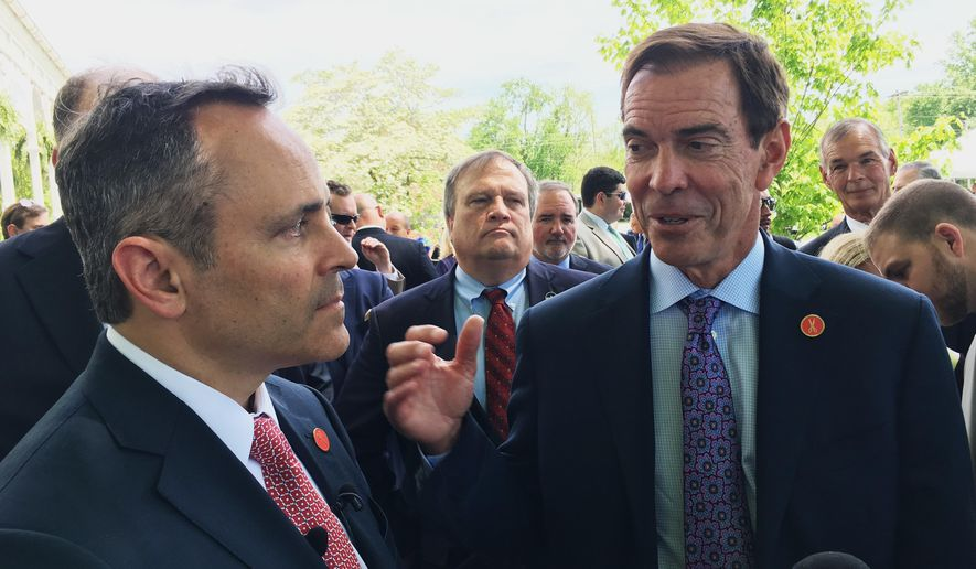 Braidy Industries Inc. CEO Craig Bouchard, right, and Republican Gov. Matt Bevin speak with reporters in Wurtland, Ky, Wednesday, April 26, 2017. The aluminum company says it will spend $1.3 billion to build an aluminum plant in eastern Kentucky, pledging to hire 550 people. (AP Photo/Adam Beam)