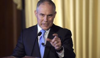 FILE - In this Feb. 21, 2017, file photo, Environmental Protection Agency (EPA) Administrator Scott Pruitt speaks to employees of the EPA in Washington. Sen. Sheldon Whitehouse filed an ethics complaint on April 25 against EPA Administrator Scott Pruitt over a planned May 5 appearance as the keynote speaker at the Oklahoma Republican Party's annual gala dinner. The Rhode Island Democrat says that would violate the Hatch Act, which limits the political activities of executive branch employees. (AP Photo/Susan Walsh, File)