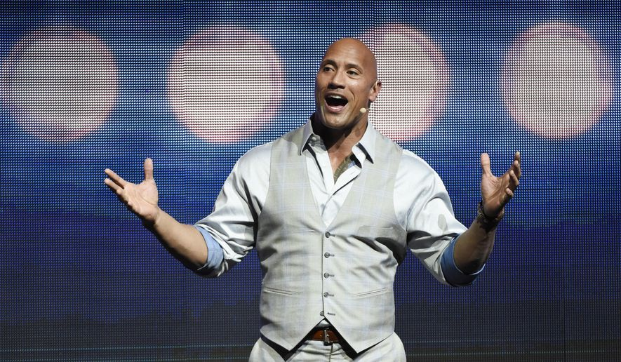 """Dwayne Johnson, a cast member in the upcoming film """"Baywatch,"""" addresses the audience during the Paramount Pictures presentation at CinemaCon 2017 in Las Vegas, March 28, 2017. (Photo by Chris Pizzello/Invision/AP) ** FILE **"""