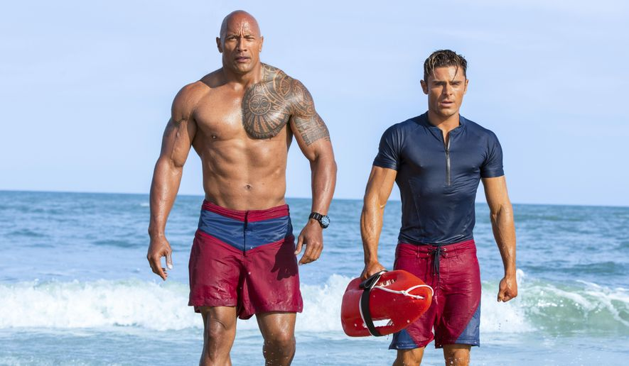 "This image released by Paramount Pictures shows Dwayne Johnson, Left, and Zac Efron in a scene from, ""Baywatch,"" in theaters May 25. (Frank Masi/Paramount Pictures via AP)"