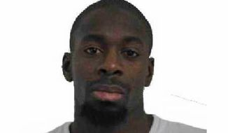 file - In this photo provided by the Paris Police Prefecture Friday, Jan. 9, 2015 shows Amedy Coulibaly who killed four people in a hostage-taking at the Hypercacher. The Paris prosecutors' office is announcing 10 arrests in an investigation of suspected suppliers of weapons to one of three attackers who killed 17 people at Charlie Hebdo magazine and a kosker store in January 2015. (AP Photo/Prefecture de Police de Paris, File)
